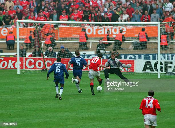 Football 1994 FA Cup Final Wembley 14th May Manchester United 4 v Chelsea 0 Manchester United's Mark Hughes scores a goal as Chelsea defenders try to...