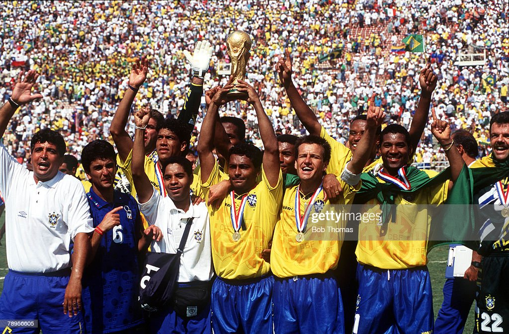 Football. 1994 World Cup Final. Pasadena, USA. 17th July 1994. Brazil 0 v Italy 0 aet. (Brazil win 3-2 on penalties). Brazil's Romario proudly holds aloft the trophy as he celebrates with team-mates after the match. : News Photo