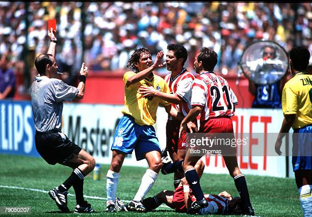 Football 1994 World Cup Finals Second Phase Palo Alto USA 4th July 1994 Brazil 1 v USA 0 Referee Quiniou shows the red card to Brazil's Leonardo...