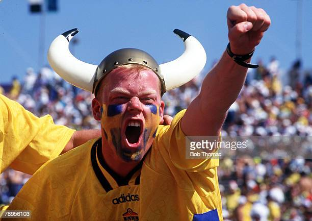 Football 1994 World Cup Semi Final Pasadena USA 13th July 1994 Brazil 1 v Sweden 0 A Swedish fan wearing a Viking hat shouts encouragement to his...