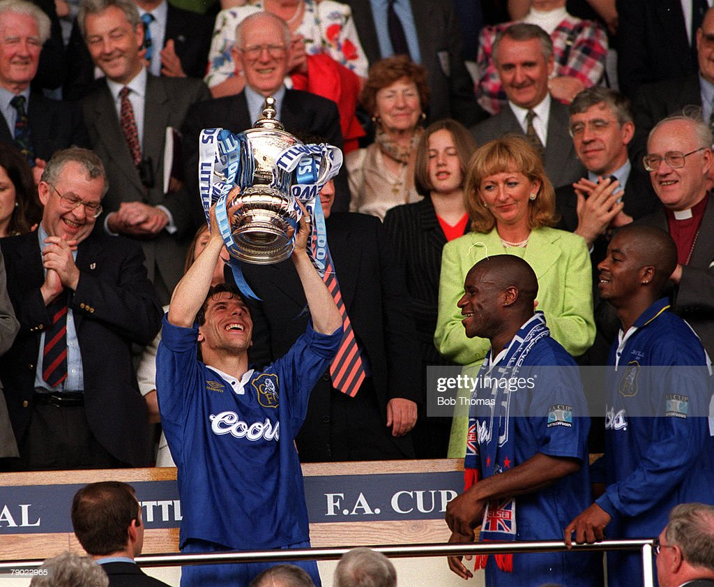 Football, 1997 FA Cup Final, Wembley, 17th May, 1997, Chelsea 2 v Middlesbrough 0, Chelsea's Gianfranco Zola proudly holds aloft the trophy after the presentation watched by Frank Sinclair and Eddie Newton