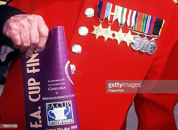 Football, 1997 FA Cup Final, Wembley, 17th May Chelsea 2 v Middlesbrough 0, A Chelsea pensioner in traditional uniform with his medals and FA Cup...