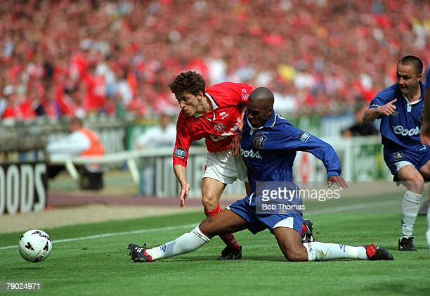 Football 1997 FA Cup Final Wembley 17th May Chelsea 2 v Middlesbrough 0 Middlesbrough's Juninho is challenged for the ball by a sliding challenge...