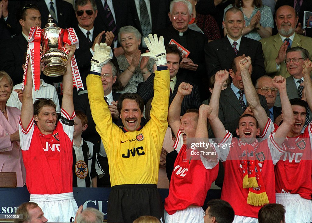 Football, 1998 FA Cup Final, Wembley, 16th May, 1998, Arsenal 2 v Newcastle United 0, Arsenal captain Tony Adams proudly holds aloft the trophy as he celebrates with goalkeeper David Seaman, Lee Dixon, Nigel Winterburn and Martin Keown