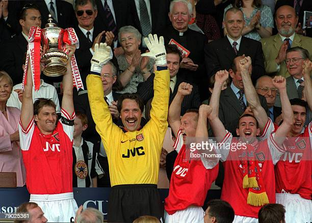 Football 1998 FA Cup Final Wembley 16th May Arsenal 2 v Newcastle United 0 Arsenal captain Tony Adams proudly holds aloft the trophy as he celebrates...