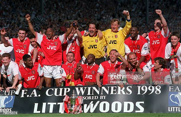 Football 1998 FA Cup Final Wembley 16th May Arsenal 2 v Newcastle United 0 The Arsenal team celebrate with the FA Cup trophy as they complete the...