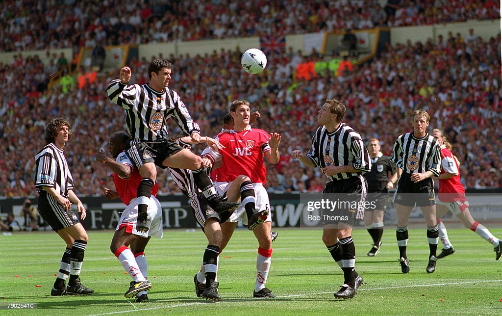 Football, 1998 FA Cup Final, Wembley, 16th May, 1998, Arsenal 2 v Newcastle United 0, Newcastle's Gary Speed jumps up high to head the ball in the air ahead of Arsenal's Cristopher Wreh and Tony Adams in a crowded penalty area