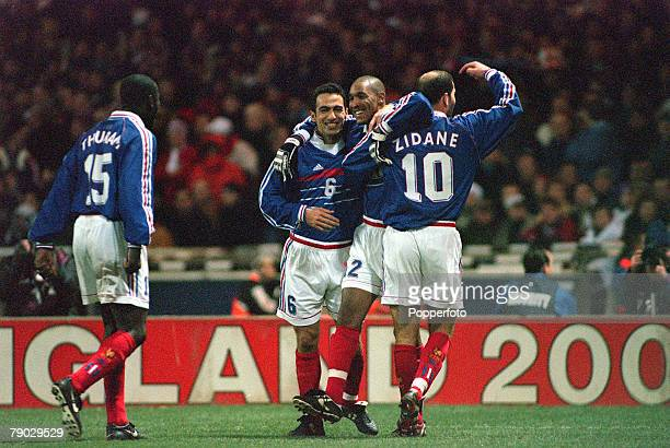 Football 1999 International Friendly Wembley 10th February England 0 v France 2 France's Nicolas Anelka is congratulated by teammates Youri Djorkaeff...