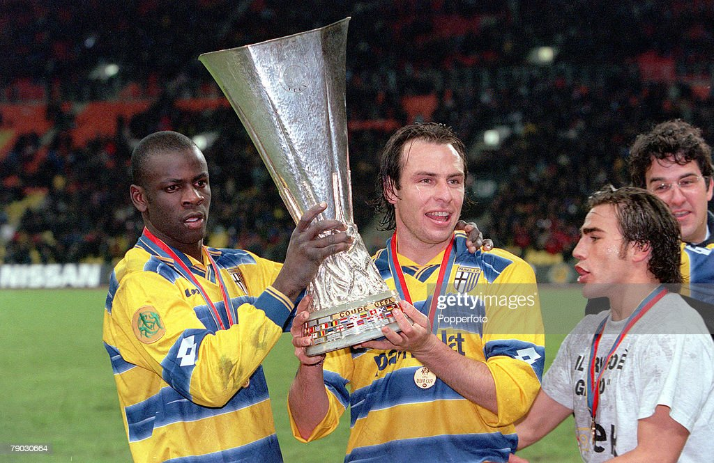 Football. 1999 UEFA Cup Final. Moscow. 12th May, 1999. Parma 3 v Marseille 0. Parma's French duo Lilian Thuram (left) and Alain Boghossian hold aloft the trophy. : News Photo