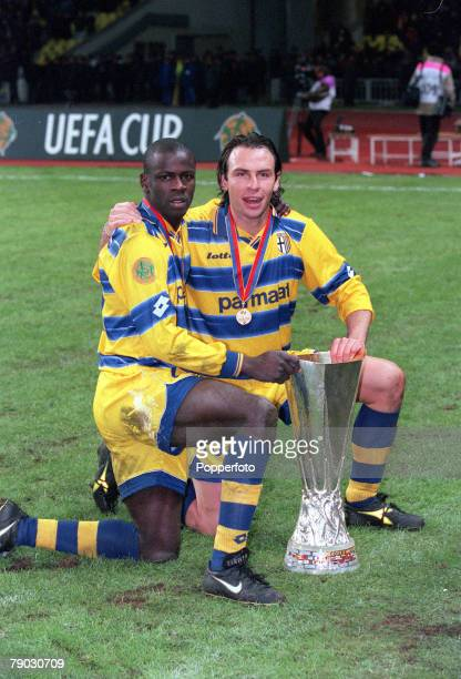 Football 1999 UEFA Cup Final Moscow 12th May Parma 3 v Marseille 0 Parma's French duo Lilian Thuram and Alain Boghossian celebrate with the trophy