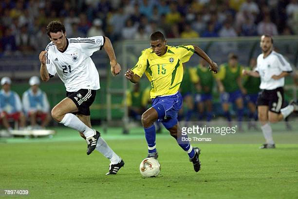 Football 2002 FIFA World Cup Final Yokohama Japan 30th June 2002 Germany 0 v Brazil 2 Brazil's Kleberson watched by Germany's Christoph Metzelder