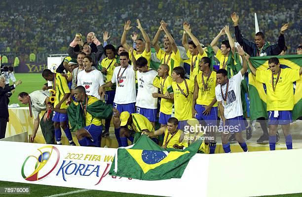 Football, 2002 FIFA World Cup Final, Yokohama, Japan, 30th June 2002, Germany 0 v Brazil 2, The Brazilian team celebrate victory on the podium