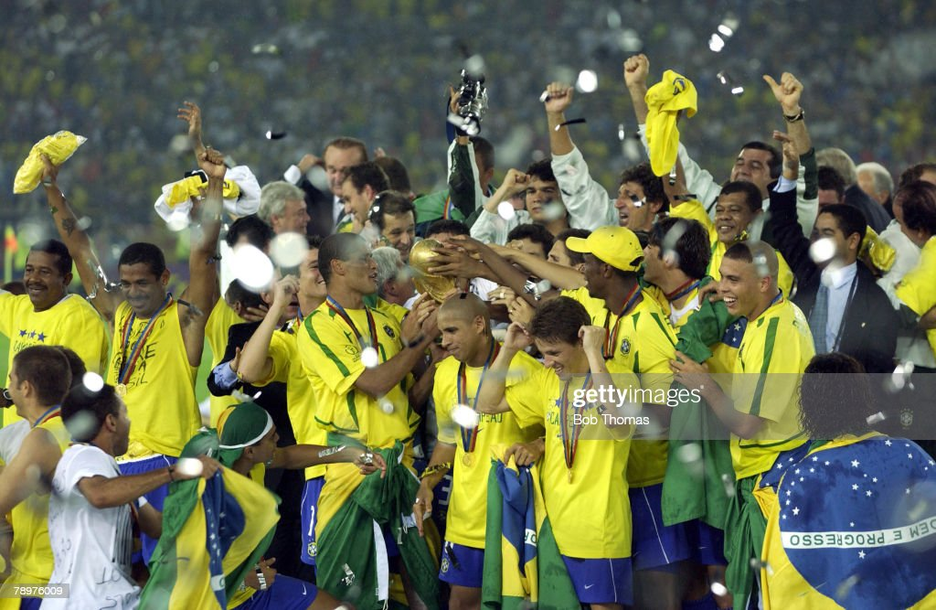 BT Football. 2002 FIFA World Cup Final. Yokohama, Japan. 30th June 2002. Germany 0 v Brazil 2. The Brazilian team celebrate victory with the World Cup trophy on the podium. : News Photo
