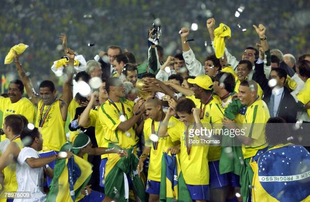 Football 2002 FIFA World Cup Final Yokohama Japan 30th June 2002 Germany 0 v Brazil 2 The Brazilian team celebrate victory with the World Cup trophy...
