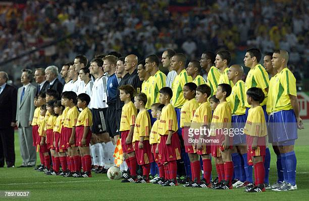 Football 2002 FIFA World Cup Final Yokohama Japan 30th June 2002 Germany 0 v Brazil 2 The Brazilian and German teams line up at the start of the match