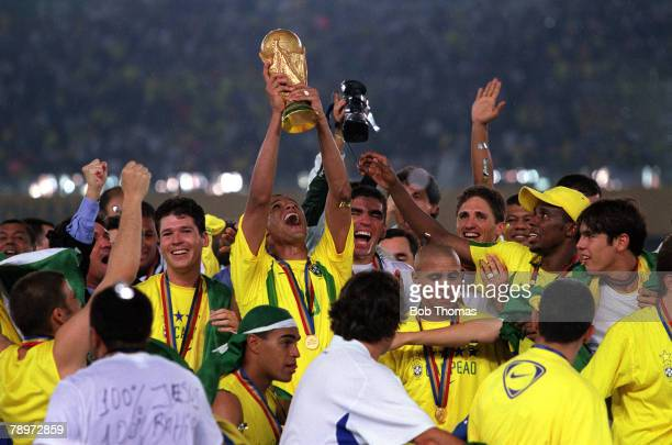 Football 2002 FIFA World Cup Final Yokohama Japan 30th June 2002 Brazil 2 v Germany 0 Brazil's Gilberto Silva holds the World Cup trophy aloft as he...