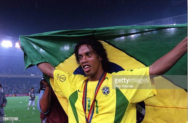 Football 2002 FIFA World Cup Finals Final Yokohama Japan 30th June 2002 Germany 0 v Brazil 2 Brazil's Ronaldinho celebrates with a Brazil flag after...