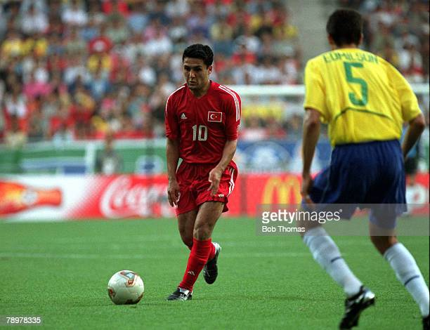 Football 2002 FIFA World Cup Finals Group C Ulsan South Korea 3rd June 2002 Brazil 2 v Turkey 1 Turkey's Yildiray Basturk is closed down by Brazil's...