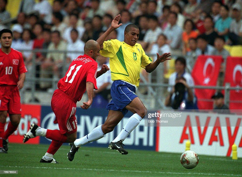 Football. 2002 FIFA World Cup Finals. Group C. Ulsan, South Korea. 3rd June 2002. Brazil 2 v Turkey 1. Brazil's Gilberto Silva is faced by Turkey's Hasan Sas.Credit: POPPERFOTO/JOHN MCDERMOTT : News Photo