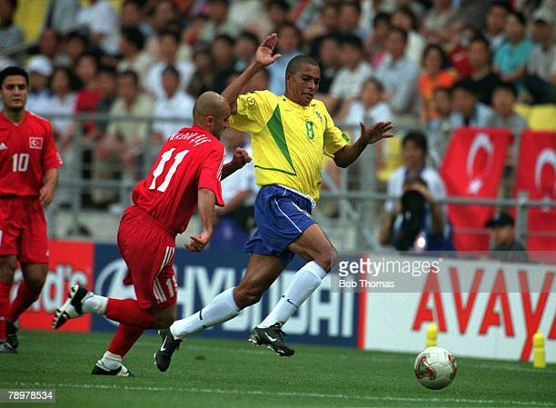 Football 2002 FIFA World Cup Finals Group C Ulsan South Korea 3rd June 2002 Brazil 2 v Turkey 1 Brazil's Gilberto Silva is faced by Turkey's Hasan...