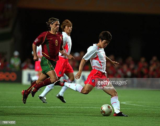 Football 2002 FIFA World Cup Finals Group D Incheon South Korea 14th June 2002 South Korea 1 v Portugal 0 South Korea's Park Ji Sung is chased by...