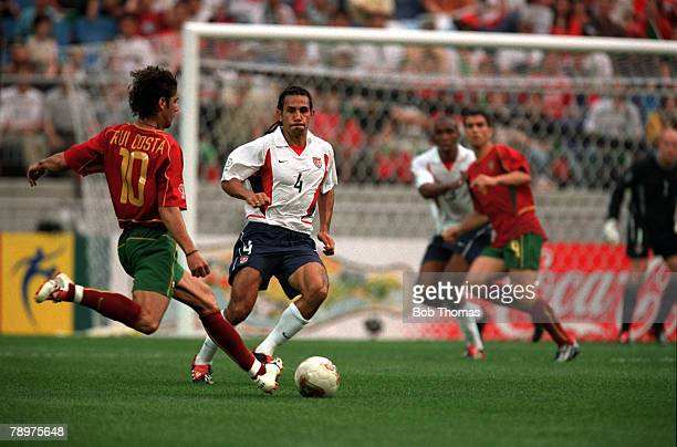 Football 2002 FIFA World Cup Finals Group D Suwon South Korea 5th June 2002 USA 3 v Portugal 2 Portugal's Rui Costa prepares to cross the ball as...