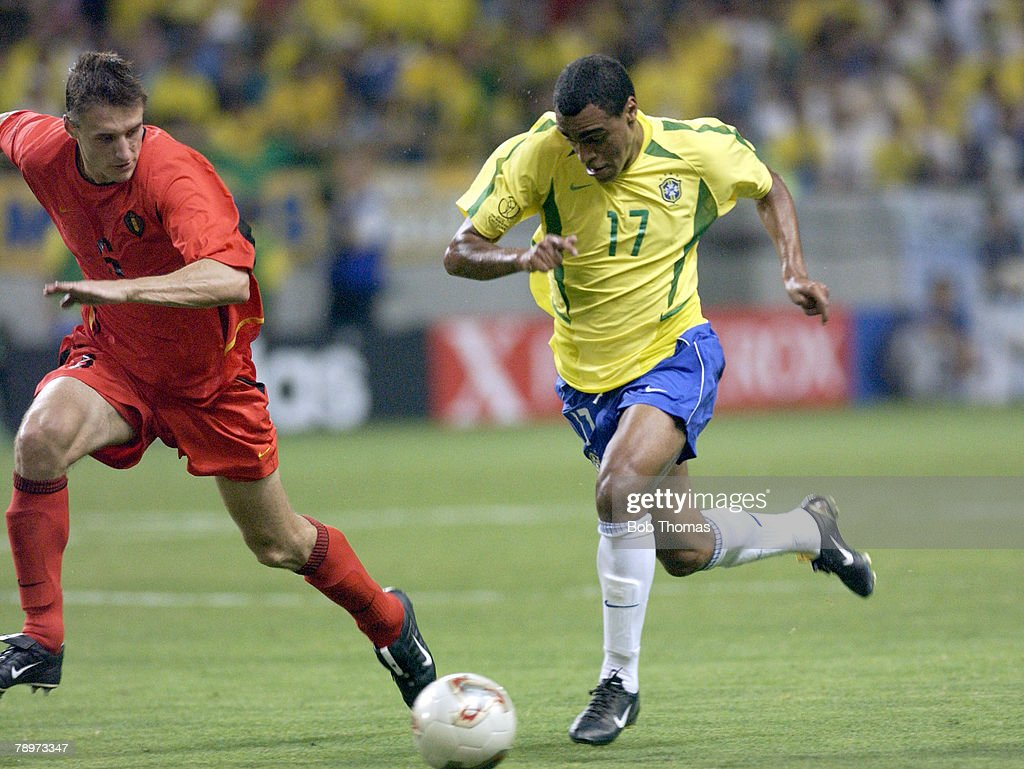 BT Football. 2002 FIFA World Cup Finals. Kobe, Japan. 17th June 2002. Brazil 2 v Belgium 0. Denilson of Brazil with Belgium's Timmy Simons. : News Photo