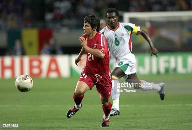 Football 2002 FIFA World Cup Finals Osaka Japan 22nd June 2002 Senegal 0 v Turkey 1 Turkey's Emre Belozoglu escapes the challenge of Senegal's Aliou...