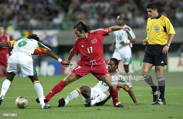 Football 2002 FIFA World Cup Finals Osaka Japan 22nd June 2002 Senegal 0 v Turkey 1 Turkey's Iihan Mansiz passes past Senegal's Aliou Cisse