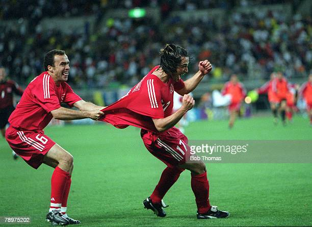 Football, 2002 FIFA World Cup Finals, Quarter Final, Osaka, Japan, 22nd June 2002, Senegal 0 v Turkey 1, Turkey's Arif Erdem pulls the shirt of...