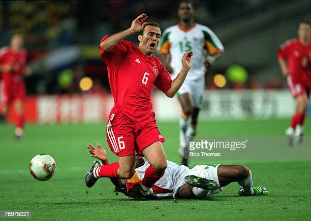 Football 2002 FIFA World Cup Finals Quarter Final Osaka Japan 22nd June 2002 Senegal 0 v Turkey 1 Turkey's Arif Erdem is challenged from behind by...