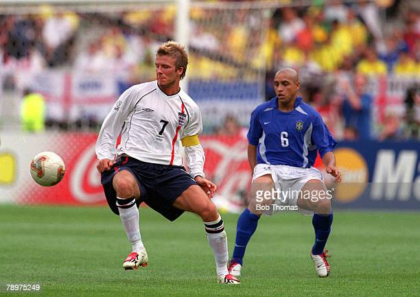 Football 2002 FIFA World Cup Finals Quarter Final Shizuoka Japan 21st June 2002 England 1 v Brazil 2 England's David Beckham with Brazil's Roberto...