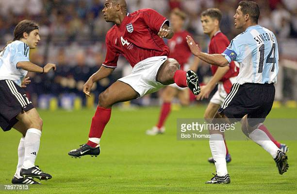 Football 2002 FIFA World Cup Finals Sapporo Japan 7th June 2002 Argentina 0 v England 1 Trevor Sinclair England jumps in mid air watched by...