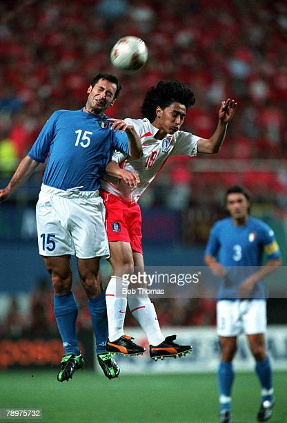 Football 2002 FIFA World Cup Finals Second Phase Daejeon South Korea 18th June 2002 South Korea 2 v Italy 1 Italy's Mark Iuliano wins a header...
