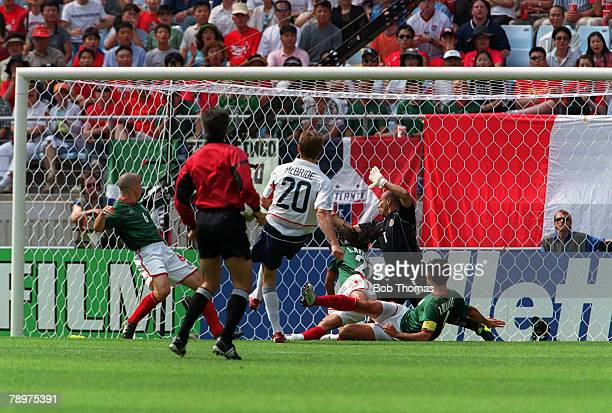Football 2002 FIFA World Cup Finals Second Phase Jeonju South Korea 17th June 2002 Mexico 0 v USA USA's Brian McBride scores their first goal in a...