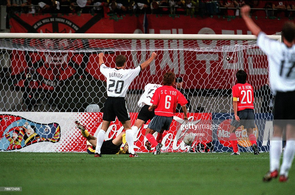 Football, 2002 FIFA World Cup Finals, Semi Final, Seoul, South Korea, 25th June 2002, Germany 1 v South Korea 0, German players celebrate as Michael Ballack (13, partially obscured) has scored the winning goal, Credit: POPPERFOTO/JOHN McDERMOTT