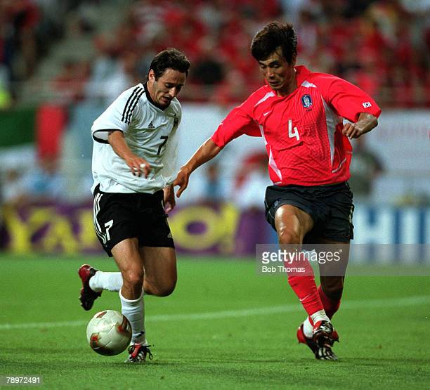 Football 2002 FIFA World Cup Finals Semi Final Seoul South Korea 25th June 2002 Germany 1 v South Korea 0 Germany's Oliver Neuville is challenged by...