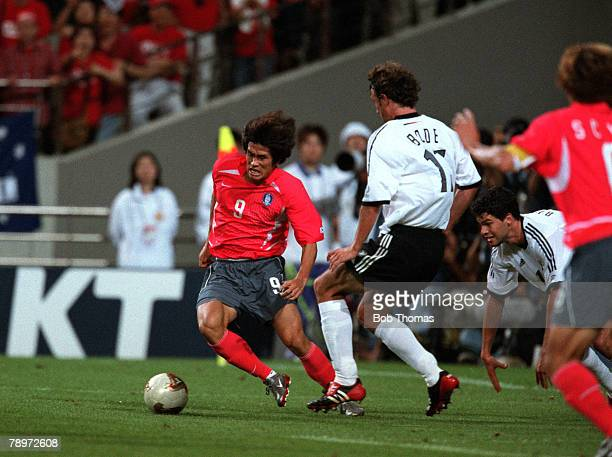Football 2002 FIFA World Cup Finals Semi Final Seoul South Korea 25th June 2002 Germany 1 v South Korea 0 South Korea's Ki Hyeon Seol is watched by...