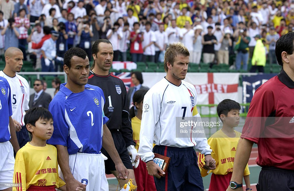 BT Football. 2002 FIFA World Cup Finals. Shizuoka, Japan. 21st June 2002. England 1 v Brazil 2. England's captain David Beckham with Brazil's captain Cafu lead out their teams into the stadium. : News Photo