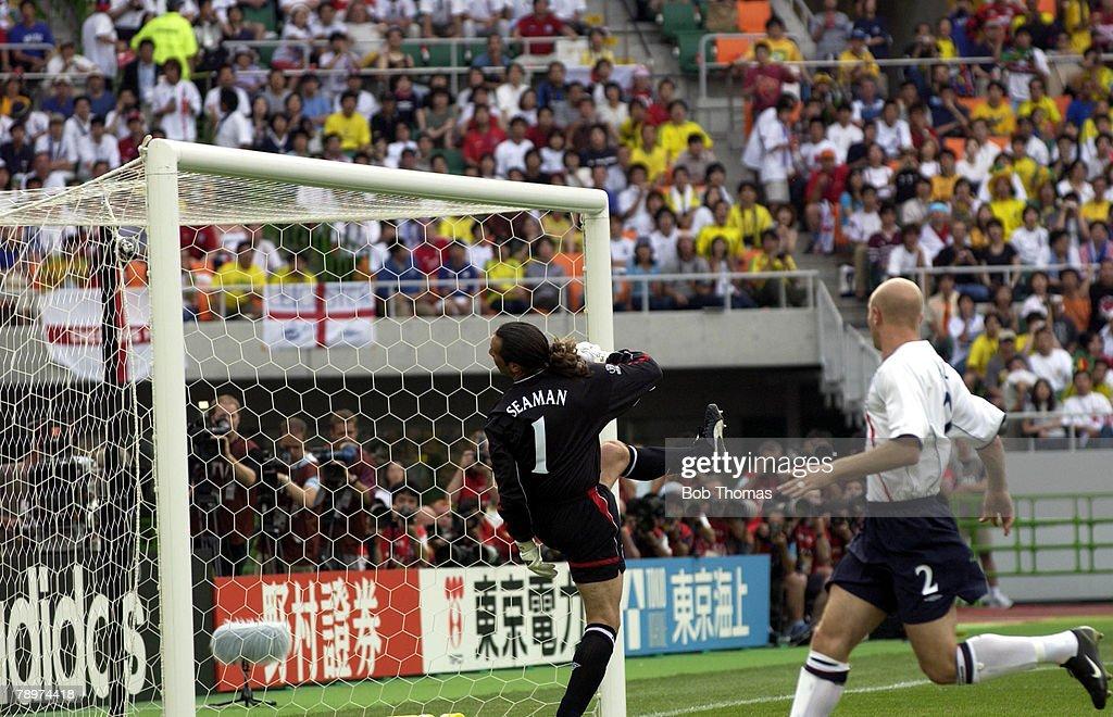 Football, 2002 FIFA World Cup Finals, Shizuoka, Japan, 21st June 2002, England 1 v Brazil 2, England goalkeeper David Seaman looks back into his goal as Brazil's Ronaldinho scores from a free kick