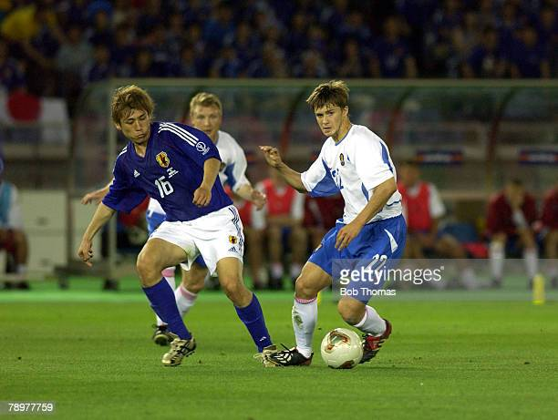 Football 2002 FIFA World Cup Finals Yokohama Japan 9th June 2002 Japan 1 v Russia 0 Russia's Dmitri Sychev with Japan's Koji Nakata