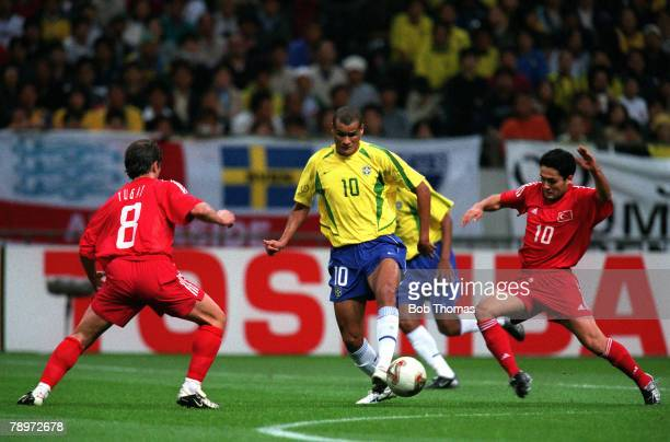 Football 2002 FIFA World Cup Semi Final Saitama Japan 26th June 2002 Brazil 1 v Turkey 0 Brazil's Rivaldo is faced by Turkey's Tugay Kerimoglu as...