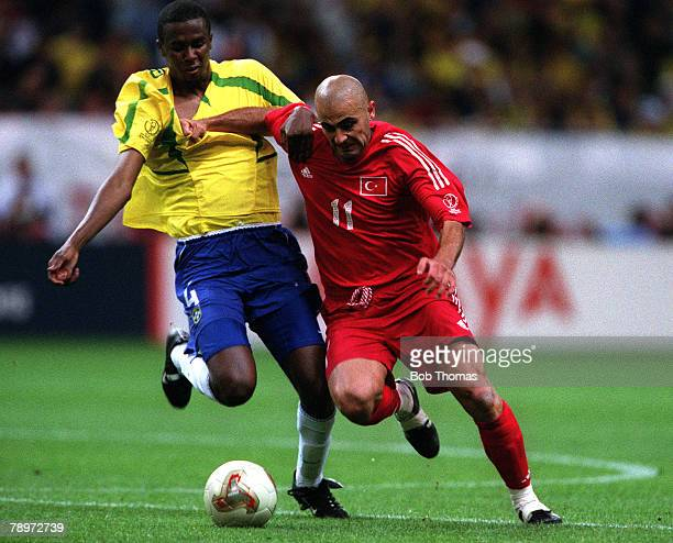 Football 2002 FIFA World Cup Semi Final Saitama Japan 26th June 2002 Brazil 1 v Turkey 0 Turkey's Hasan Sas holds off a challenge from Brazil's Roque...
