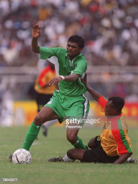 Football 2002 World Cup Qualifier Accra African Second Round Group B 11th March 2001 Ghana 0 v Nigeria 0 Nigeria's Nwankwo Kanu tries to take the...