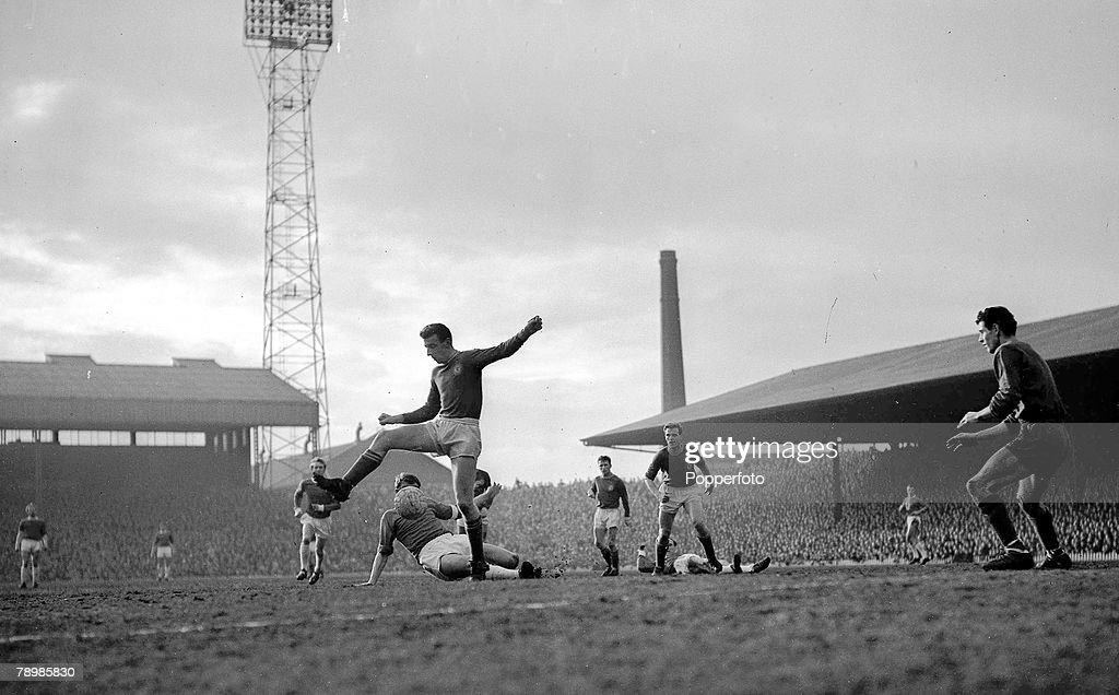 Football. 20th March 1963. Old Trafford, Manchester. FA Cup 5th Round. Manchester United 2 v Chelsea 1. A Chelsea defender attempts to clear an attack. : News Photo