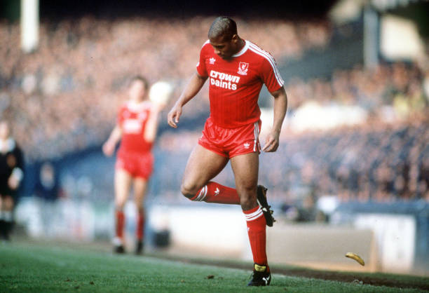 Football. 21st February 1988. FA Cup Fith Round. Goodison Park. Everton 0 v Liverpool 1. Liverpool's John Barnes backheels a banana that was thrown onto the pitch by a racist section of the crowd.