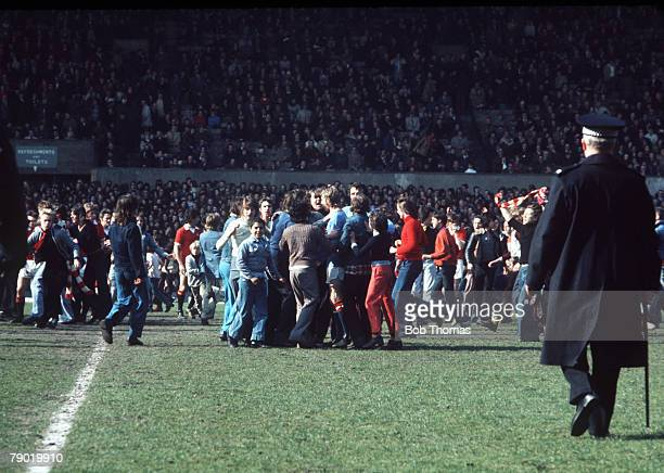 Football 27th April Old Trafford Manchester United 0 v Manchester City 1 Manchester United fans invade the pitch and mob Manchester City's Denis Law...