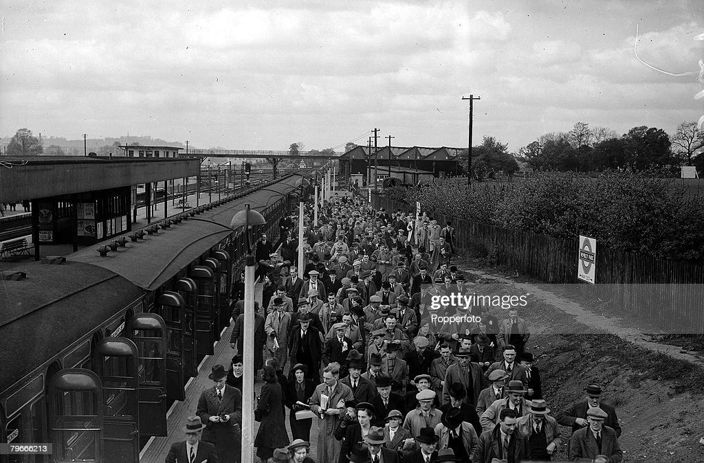 Football, 30th April 1938, Wembley, London, FA Cup Final, Preston North End v Huddersfield Town, Cup Final crowds flock to the stadium as they leave the trains at the station : News Photo