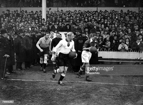 Football 4th December 1935 White Hart Lane London England 3 v Germany 0 Englands captain Eddie Hapgood and German skipper Szepan lead their teams...