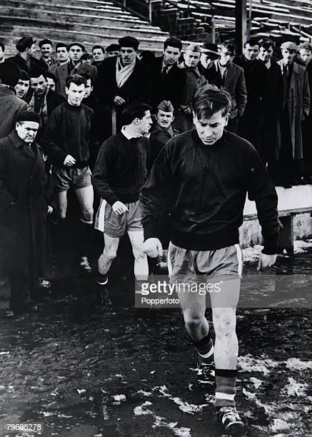 Football 4th February Bobby Charlton leads out his Manchester United teammates at practice at the Yugoslav Army Stadium in Belgrade where they will...